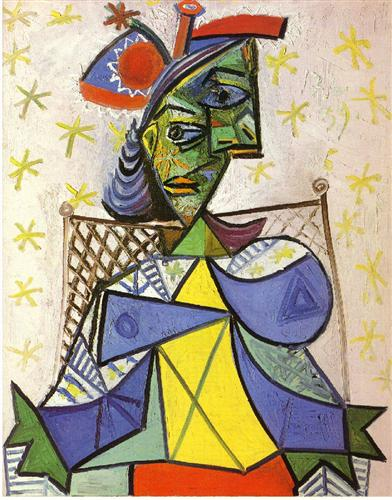 Seated woman with blue and red hat - Pablo Picasso